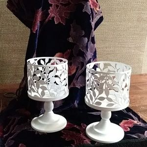 White candle pedestals with deco sleeves